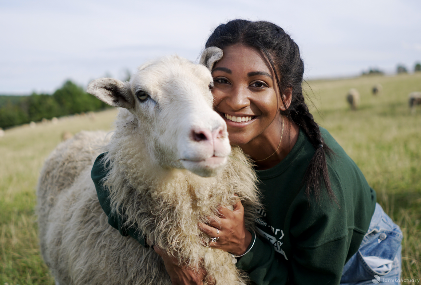 Farm Sanctuary Staff Arianna Duncan with a Sheep