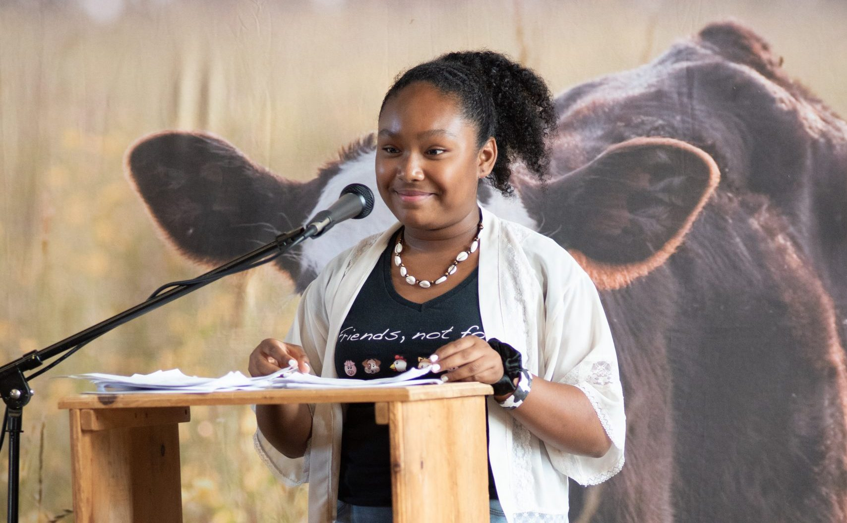 Genesis Butler speaking at a Farm Sanctuary event.