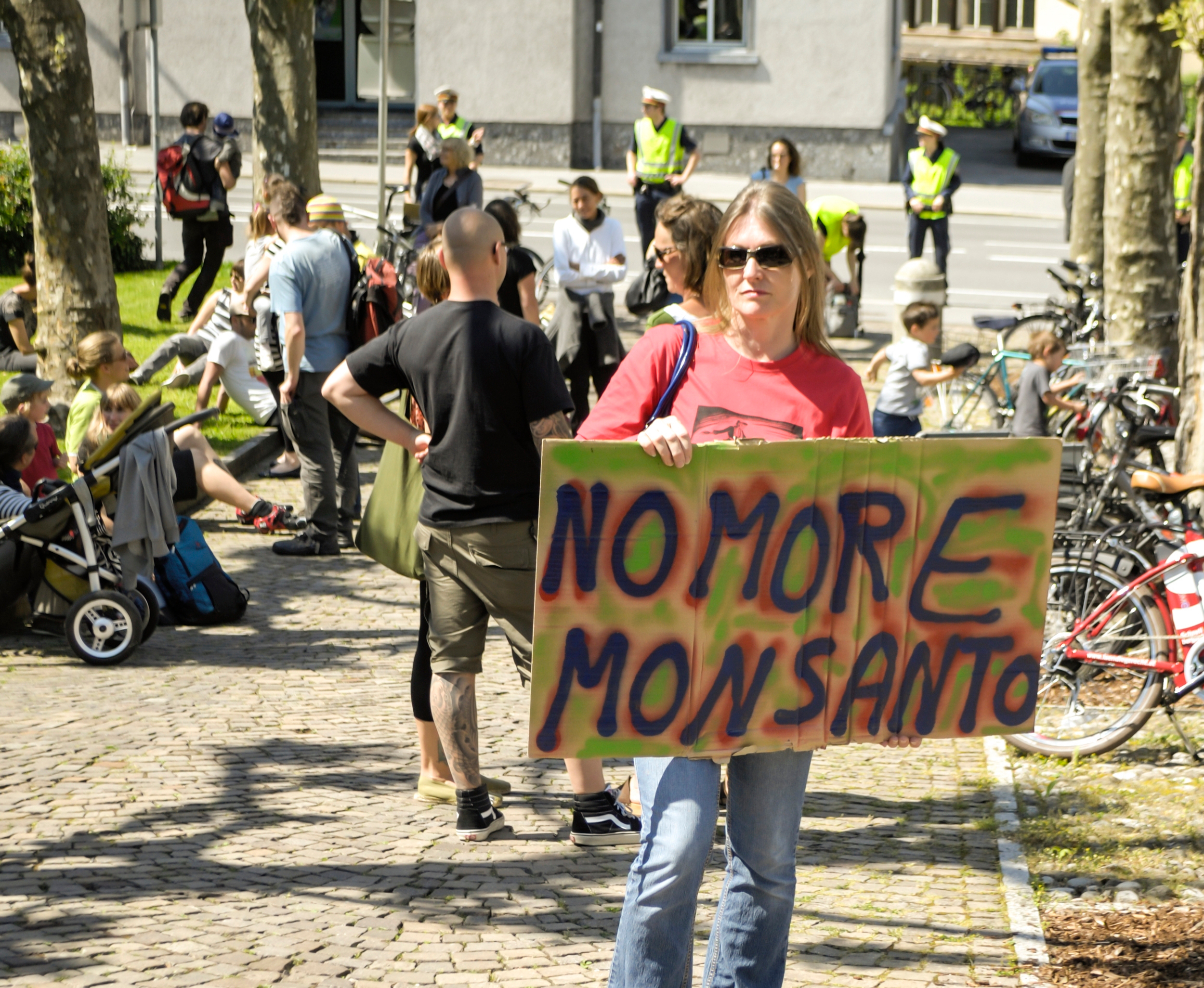 "Woman protesting with ""no more Monsanto"" sign. Photo: st.djura/Shutterstock"