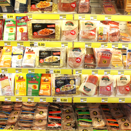Variety of processed meats and prepacked foods in a grocery store
