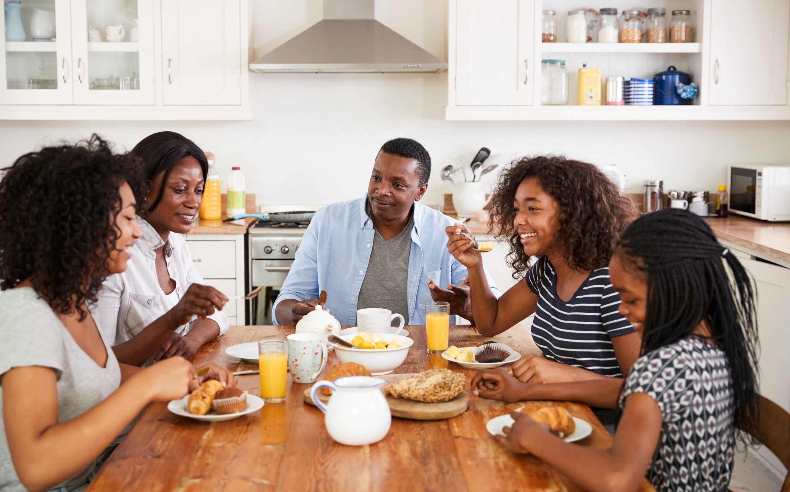 Vertical explainer photo 3 - Family With Teenage Children Eating Breakfast In Kitchen / Photo Credit: Monkey Business Images, Shutterstock