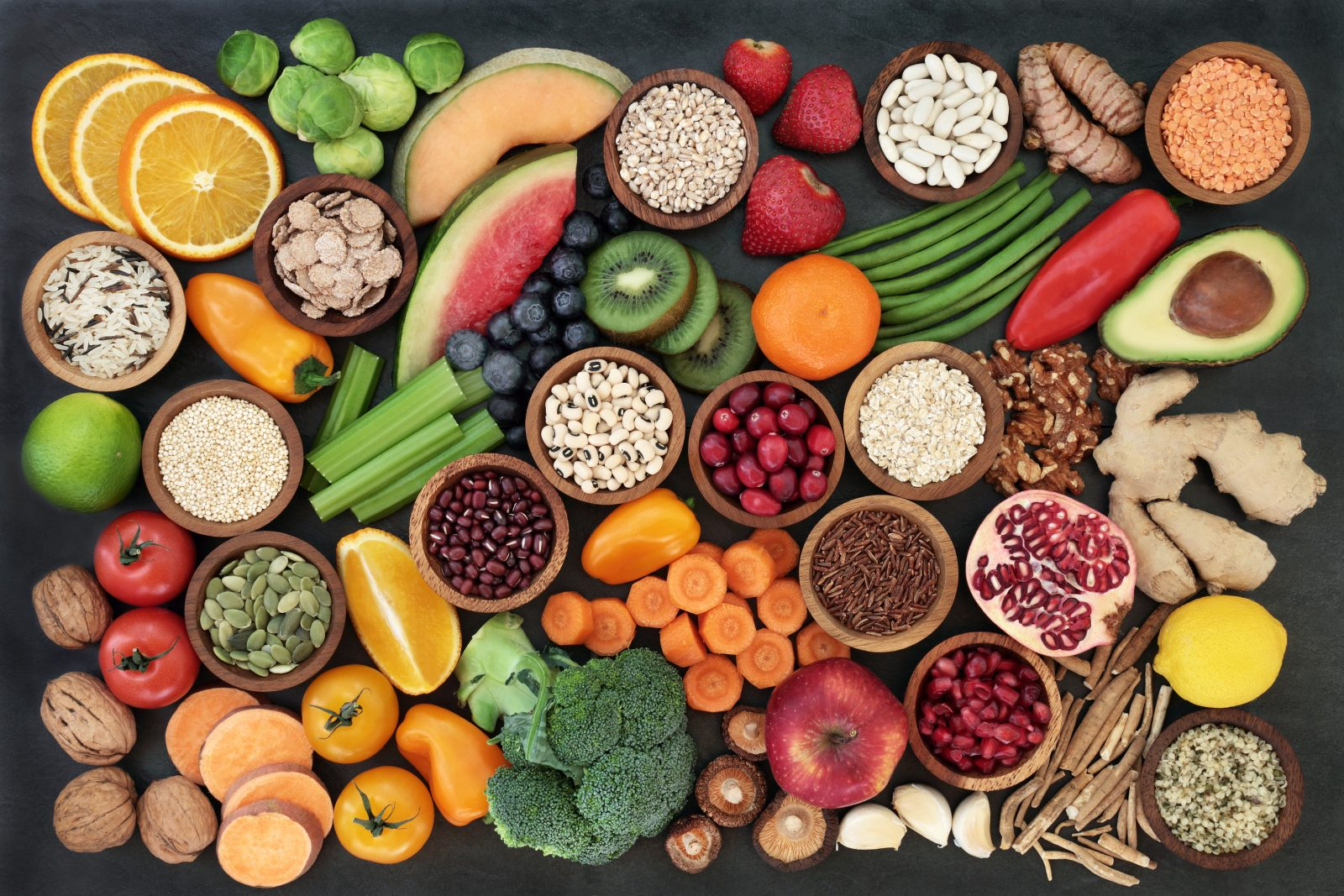 A spread of fruit, vegetables, seeds, pulses, grains, cereals, herbs & spices.