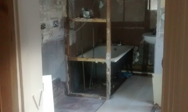 Damp proofing and insulating John and Marinas kitchen and shower room. Image