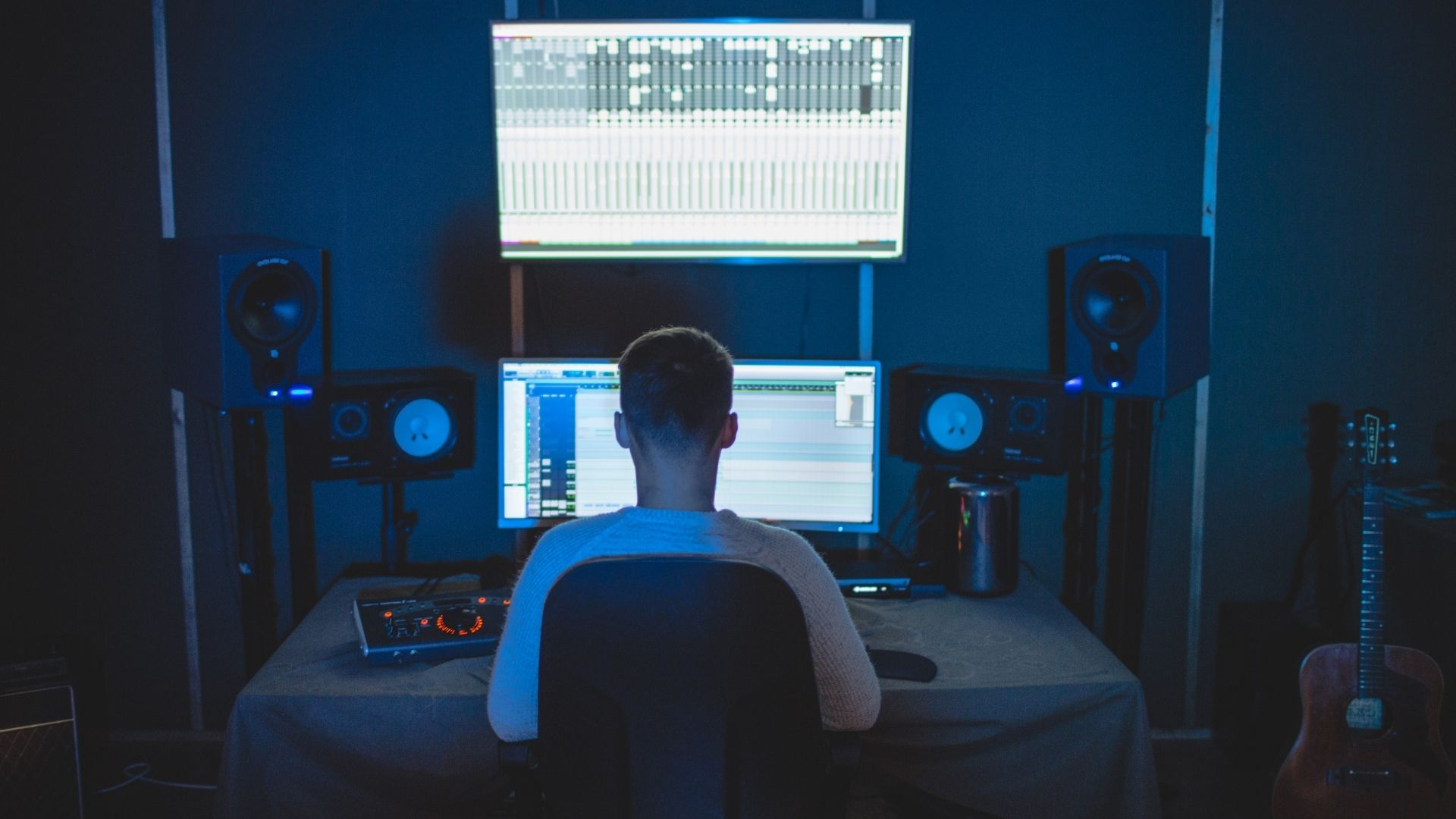 music_producer_from_the_back_blue_lighting