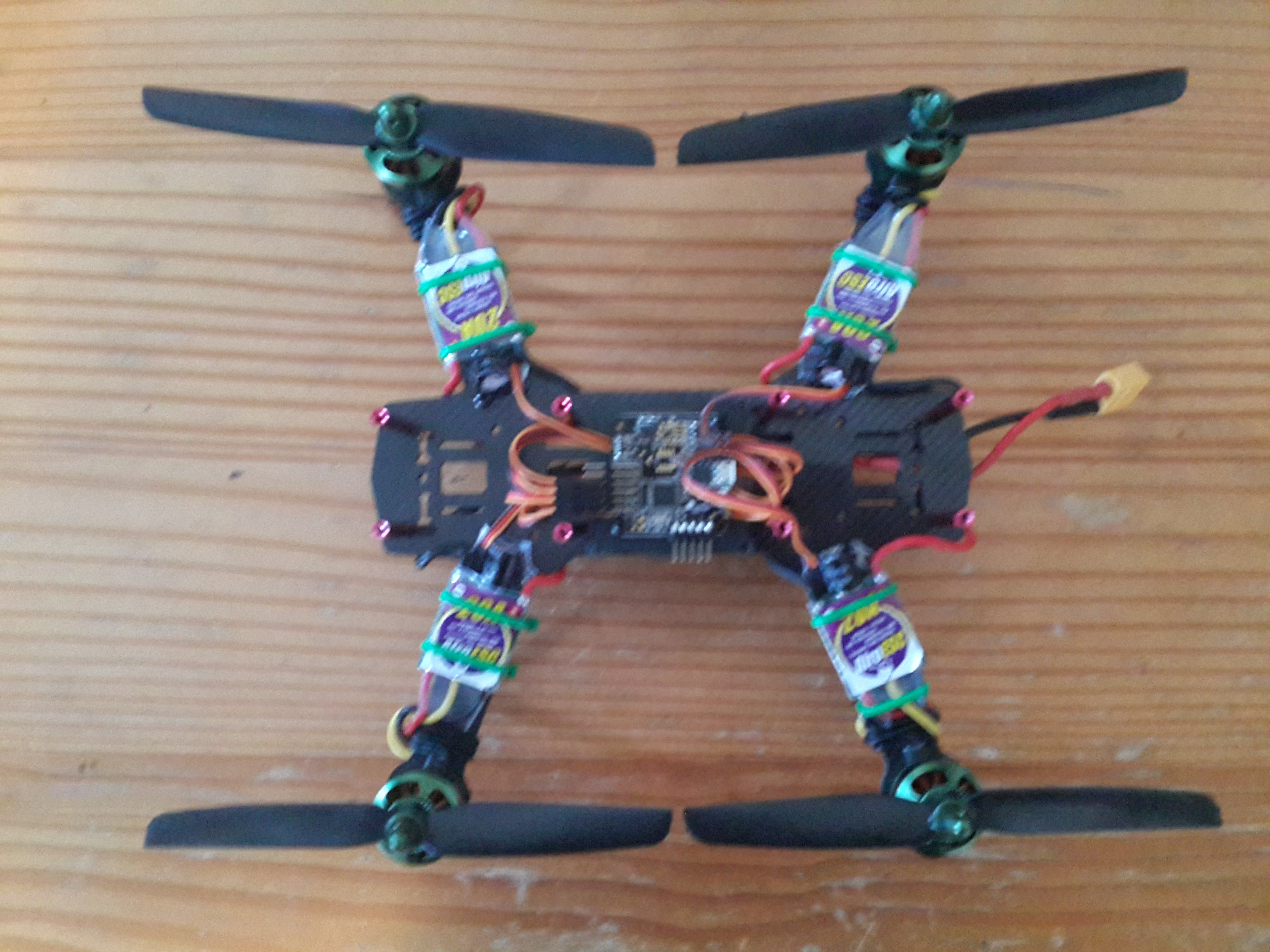 my experience the naze flite test but here is the basic flying structure of the quad motors esc s flight controller and wiring harness