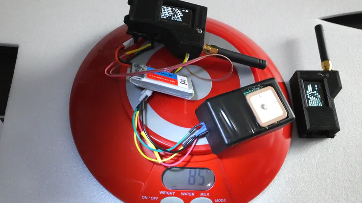 transmitter weight with battery and gps