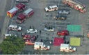 A parking lot near the Houston law firm at which a lawyer opened fire, injuring nine people.