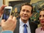 Brink of Victory? Zionist Union leader Isaac Herzog casts ballot with his wife. Polls show him leading Benjamin Netanyahu in the complicated race to be Israel's next premier.