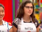 13-year-old Batia Bresca (right) explained to the judges why she would not taste her own pork dish during the cooking competition.