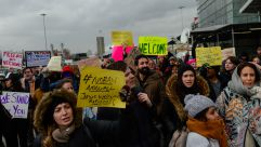 """""""Jews Welcome Refugees"""" sign at the JFK protest."""