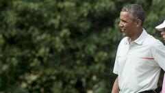 President Barack Obama plays golf.