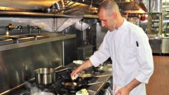 Chef Moshe Grundman cooking at his new Nyack, New York, eatery Sixty5 on Main.