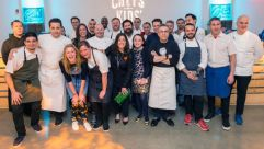 Among the lineup of star chefs at the Cookies for Kids Cancer benefit were Jonathan Benno (far right), Michael Solomonov (second from right) and Ivan Orkin (fourth from right). Cookies founder Gretchen Witt is front-center with green bag.