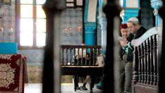 Men pray at the El Ghriba synagogue on Djerba.