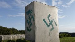 Shameful : Vandals desecrate the memorial to Jews killed by Polish neighbors in the town of Jedwabne as the Holocaust gathered pace in 1941.