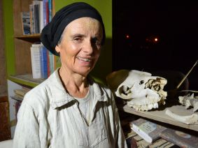 Erna Covos, founder of the Beit Hogla settlement, at her home where she displays a camel skeleton she found on the property.