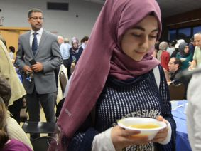 Participants get food at a Muslim-Jewish iftar dinner on June 20, 2016 at the Kings Bay Y in South Brooklyn.