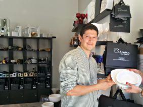 Masbia chef Ruben Diaz (left) receiving the fine china from Tammy Carmona of Carmona New York.
