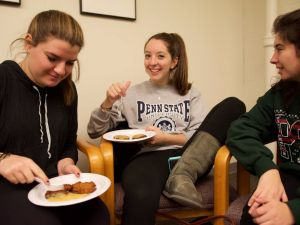 Jewish students eat latkes at Penn State Hillel.
