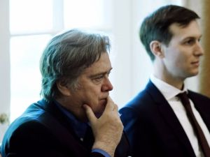Jared Kushner (R) and Steve Bannon, two of President Trump's top advisers, listen as the president speaks during a meeting in the Cabinet Room of the White House, June 12, 2017.