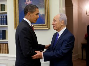 President Barack Obama welcomes Israeli President Shimon Peres in the Oval Office, Tuesday, May 5, 2009.