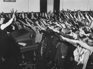 German children give the Nazi salute.