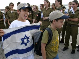 Children of North American Jews carrying an Israeli flag arrive at Ben-Gurion airport.