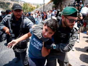 Israeli border guards detain a Palestinian youth during a demonstration outside the entrance to Al-Aqsa mosque compound due to newly-implemented security measures by Israeli authorities in response to a terror attack.