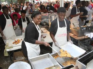 Vendors prepare food at the second annual Fried Chicken Festival in New Orleans.