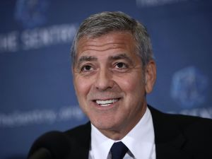George Clooney smiles during a press conference about corruption in South Sudan in Washington, D.C.