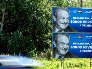 "Hungary's Jewish federation said that billboards depicting George Soros laughing ""recall Hungary's dark periods."""