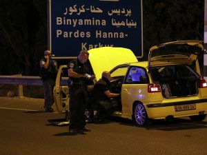 Israeli security forces and forensics inspect a car used by an Israeli Arab to attack a group of Jews near the northern Israeli kibbutz Gan Shmuel, on October 11, 2015.