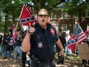 A KKK member at a rally for protecting monuments to Confederate figures in July in Charlottesville, Virginia.