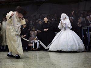 A bride and her grandfather dance at an ultra-Orthodox wedding in Jerusalem in 2012.