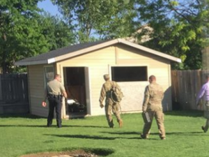 The Mountain Home Air Force Base military explosives team inspects a Nazi-era bomb found in a shed in Idaho.