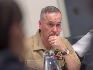 Marine Corps Gen. Joseph F. Dunford Jr., chairman of the Joint Chiefs of Staff, listens during a meeting with military leaders from South Korea and Japan.