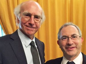 """Cantor Kenny Ellis posing with """"Curb Your Enthusiasm"""" creator Larry David."""