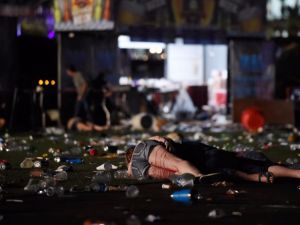 A person lies on the ground covered with blood at the Route 91 Harvest country music festival after apparent gun fire was heard on October 1, 2017 in Las Vegas, Nevada.