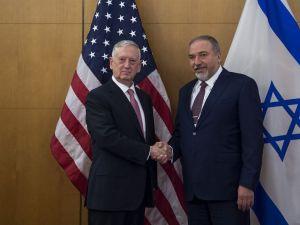 Defense Secretary Jim Mattis, left, meets with Israeli Defense Minister Avigdor Liberman.