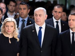 (From R) French President Emmanuel Macron, Israeli Prime Minister Benjamin Netanyahu and his wife Sara Netanhayu attend a ceremony commemorating the 75th anniversary of the Vel d'Hiv roundup in Paris on July 16, 2017.