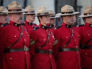 The Royal Canadian Mounted Police stand at a memorial ceremony.