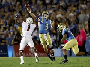 UCLA quarterback Josh Rosen completes a pass against Arizona.