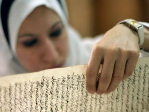 Echoes of Lost Civilization: An Iraqi employee examines a document in the Jewish archives in Baghdad.