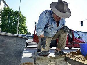 Step in Stone: German artist Gunter Demnig works on his 'Stumbling Blocks' Holocaust memorial.