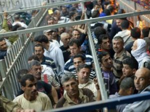 You Call This Life? West Bank Palestinian workers wait an an Israeli checkpoint near Hebron.