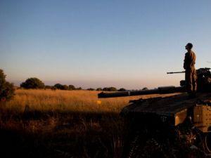 Watching the Border: An Israeli soldier on a tank on the Israeli-Syrian border near Quneitra.