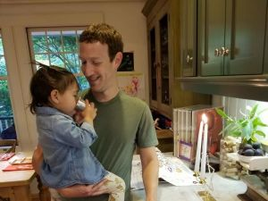 Facebook founder and CEO Mark Zuckerberg celebrates Shabbat with his two-year-old daughter Max.