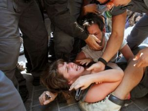 Book Her: Israel police arrest Daphne Leef during a social justice protest last year.