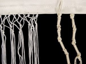 Fringe Festival: Making tzitzit involves pushing three short strings and one long one through a tiny eyehole.