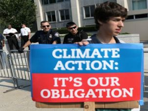 "Turning up the Heat: Michael Greenberg, a Jewish college student, joins a protest against the Keystone XL pipeline in August 2013. Jewish groups are lining up behind the upcoming ""People's Climate March,"" billed as the 'largest mobilization' of its kind."